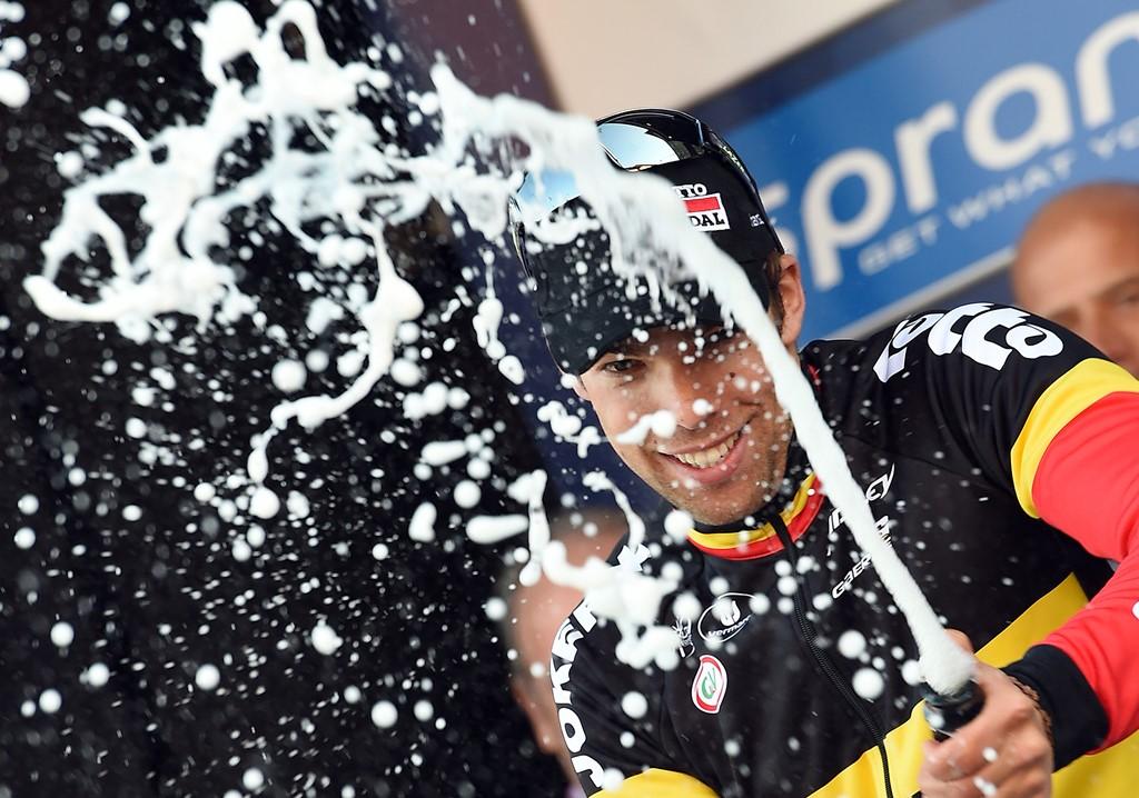 Il ciclista belga del Lotto Soudal Team Jens Debusschere fesetggia sul podio la vittoria nella seconda tappa Tirreno-Adriatico da Lido di Camaiore a Cascina, 12 del marzo 2015. ANSA/DANIEL DAL ZENNNARO